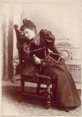 1890's woman photo long black dress